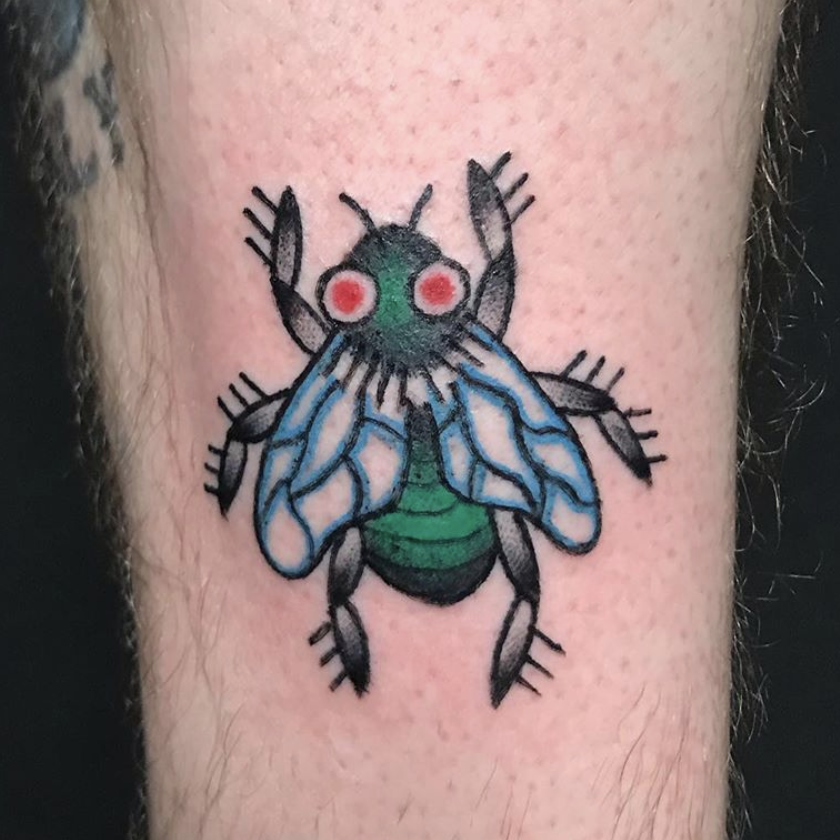 Tattoo of a fly